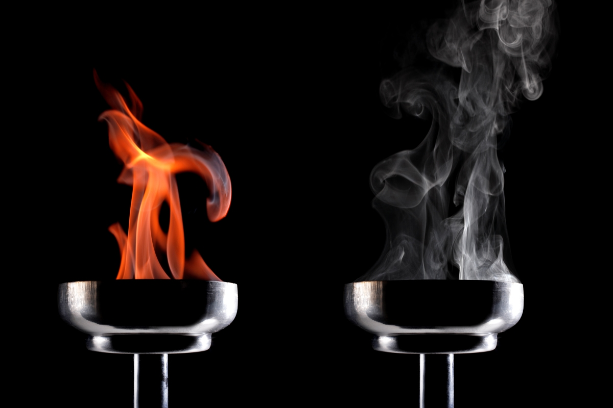 burning torch next to smoking torch