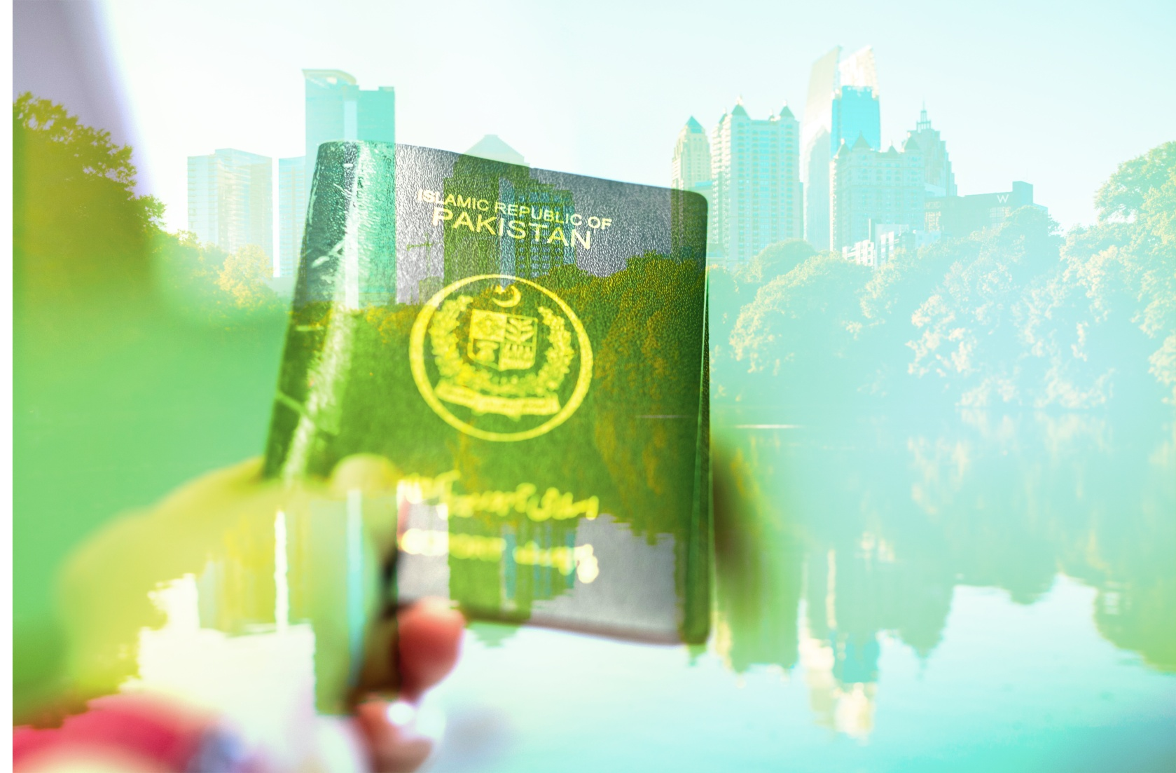 hand showing Pakistani passport